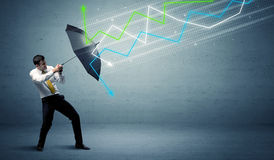 Business person with umbrella and stock market arrows concept Royalty Free Stock Photography