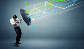 Business person with umbrella and stock market arrows concept Royalty Free Stock Photos