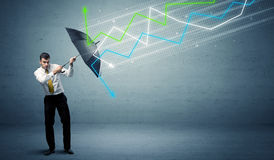 Business person with umbrella and stock market arrows concept Royalty Free Stock Images