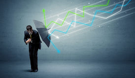 Business person with umbrella and stock market arrows concept Stock Image