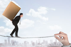 Business person walking on the chain Stock Image