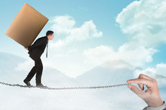 Business person walking on the chain Stock Photos