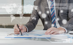Business person working on computer against technology background Stock Photos