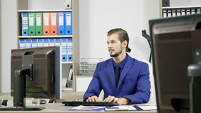 Business person working in office and typing on the keyboard. Of the computer stock video