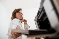 Business person working woth printer Royalty Free Stock Image
