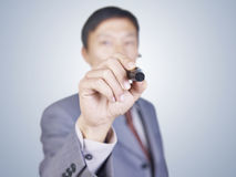 Business person writing on glass Stock Image