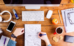 Business person writing and working, wearing smart watch Royalty Free Stock Photos