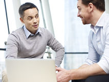 Business persons chatting gossiping in office Stock Photography