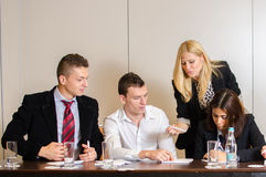 Business persons talking and writing Stock Photo