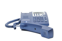 Business phone close up. Modern blue business office telephone on a white background Royalty Free Stock Images