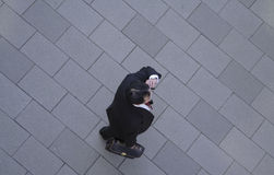 Business phone discussion. Businessman using mobile phone-upper view Royalty Free Stock Image