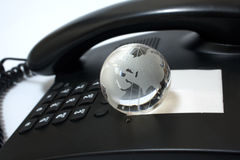 Business phone and glass globe Stock Images