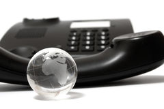 Business phone and glass globe Stock Photos