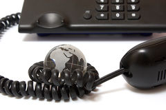 Business phone and glass globe Royalty Free Stock Image