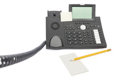 Business phone with memo and pencil Royalty Free Stock Photo