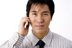 Business Phonecall. An asian businessman takes a phone call on his cellphone Royalty Free Stock Photos