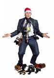 Business photographer with a lot of photo cameras. In Christmas hat at white background Royalty Free Stock Photography