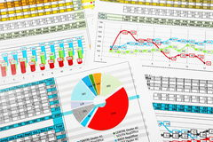Business Pie Chart and Bar Graph Reports. Multicolor Business Pie Chart and Bar Graph Reports Stock Photo