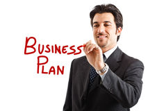 Business plan. Portrait of a smiling businessman writing Business plan on the screen Stock Photos