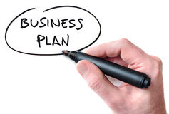 Business Plan. Hand writing Business Plan on whiteboard Stock Image