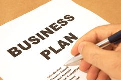 Business plan. Businessman ready to check the business plan Stock Image