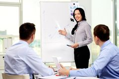 Business plan. Smiling business lady carrying out presentation of a business plan Stock Photo
