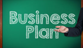 Business Plan on blackboard is presenting by businessman Stock Image