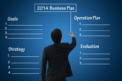 2014 Business plan with blank chart. Businessman writing 2014 business plan present by blank or empty chart Stock Image