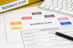 Business plan checklist and paperwork Stock Image