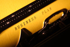 Business Plan. Closeup of yellow paper with BUSINESS PLAN inscription in typewriter Stock Photos