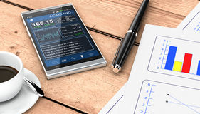 Business plan concept. Close up view of a couple of paper sheets of a business plan, a pen, a cup of coffee, a smartphone with a financial app, wooden background Royalty Free Stock Images
