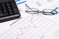 Business plan concept - graphs, charts, glasses and keyboard Stock Image