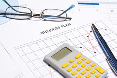 Business plan concept - graphs, charts, pen and calculator Stock Images