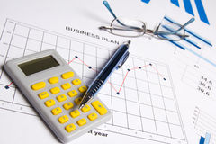 Business plan concept - graphs, charts, pen, glasses and calcula Stock Photos