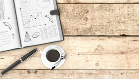 Business plan concept. Top view of an open paper notebook, a pen and a cup of coffee. hand drawn doodles of business plan, some space for custom text at the Royalty Free Stock Photo