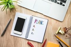 Business plan concepts with notepad paper on wooden table and supplies. Flat lay design Royalty Free Stock Photos