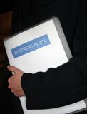 Business plan - corporate. Corporate person with a business plan folder stock photo