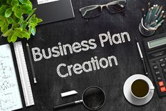 Business Plan Creation on Black Chalkboard. 3D Rendering. Business Plan Creation - Black Chalkboard with Hand Drawn Text and Stationery. Top View. 3d Rendering Stock Photo