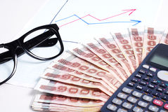Business plan. With graph and calculator,money and glass Stock Photos