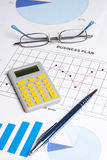 Business plan with graphs, charts and calculator Royalty Free Stock Photography
