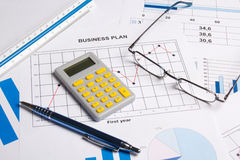 Business plan with graphs, charts and calculator Stock Photography