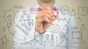 Business plan, illustrazione di concetto, scrittura dell'uomo sullo schermo trasparente Fotografia Stock Libera da Diritti