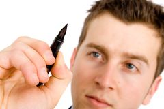 Business plan - man with pen Stock Image