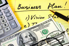 Business plan with  money and calculator Stock Images