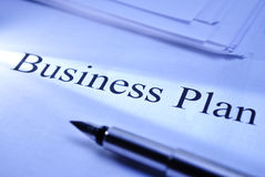 Business plan. Pen lying on a document titled Business Plan conceptual of planning and strategy for improved performance and growth within a corporate business Stock Image