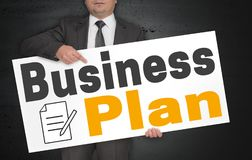 Business plan poster is held by businessman royalty free stock images