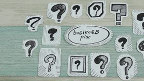 The business plan in questions. The sketch of the business plan among question marks stock video