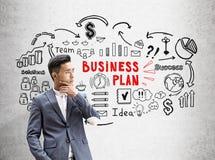 Business plan rosso e nero asiatico dell'uomo d'affari, Fotografia Stock Libera da Diritti