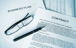 Business plan series. Selective focus image of business plan, contract, ballpoint pen and glasses stock photo