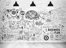 Business plan sketch on a brick wall Royalty Free Stock Photo